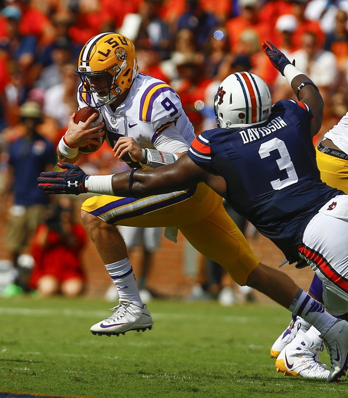 differently d0e93 4c614 LSU quarterback Joe Burrow (9) carries the ball past Auburn defensive  lineman Marlon Davidson (3) for the first down during the first half of an  NCAA ...