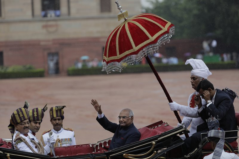 In this Tuesday, July 25, 2017, file photo, India's new President Ram Nath Kovind, waves as he arrives in a traditional horse driven carriage at the Presidential Palace after being sworn in, New Delhi, India. Kovind, a Hindu nationalist leader backed by Prime Minister Narendra Modi was elected last week as India's 14th president, a largely ceremonial position.