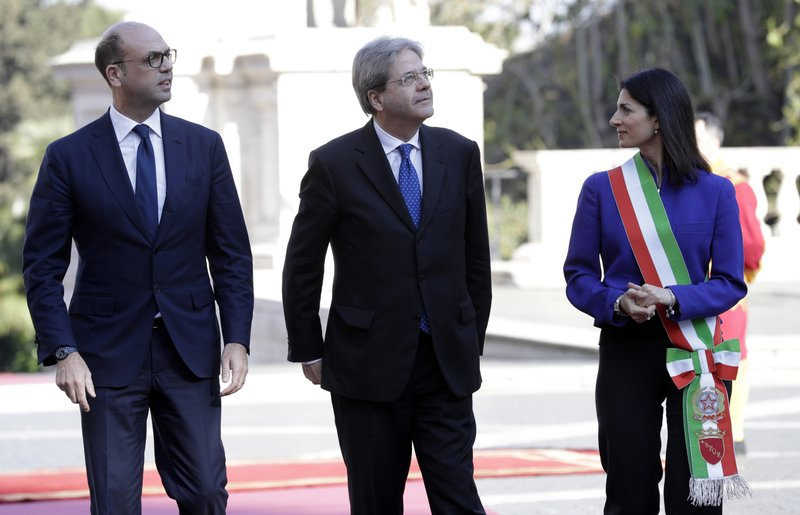 The Mayor of Rome, Virginia Raggi, right, stands with Italian Prime Minister Paolo Gentiloni, center, and Italian Foreign Minister Angelino Alfano, left, during arrivals for an EU summit at the Palazzo dei Conservatori in Rome on Saturday, March 25, 2017. EU leaders gather in Rome on Saturday to celebrate the 60th anniversary of the EU's founding treaty.