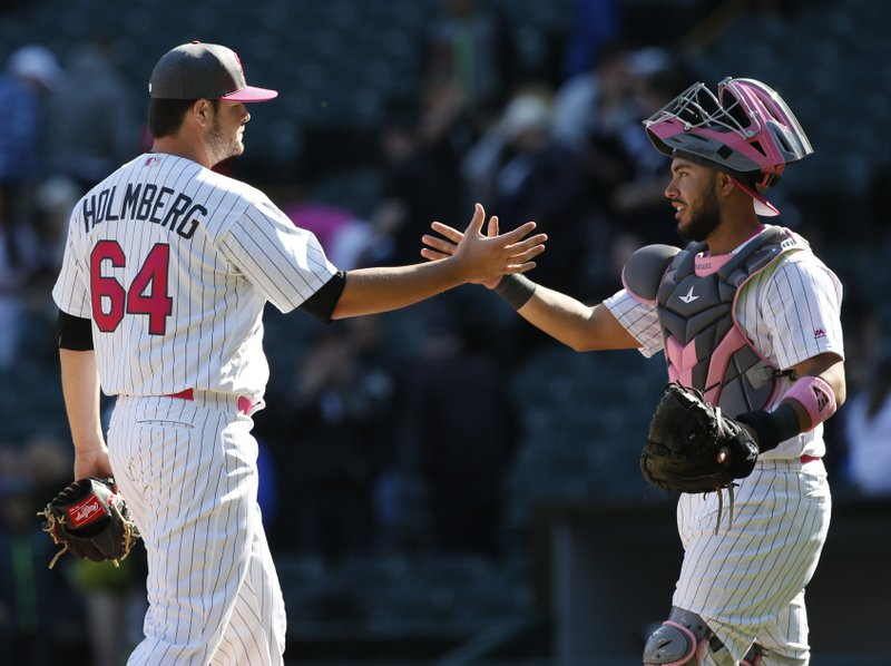 Chicago White Sox relief pitcher David Holmberg, left, celebrates with catcher Omar Narvaez after they defeated the San Diego Padres in an interleague baseball game in Chicago, Sunday, May 14, 2017. (AP Photo/Nam Y. Huh)