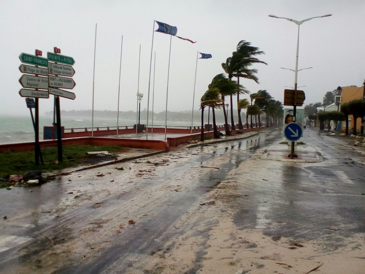 The Latest: 150K without power on 2 French Caribbean islands