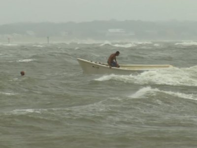 Fishermen brave rough waters ahead of VA storm