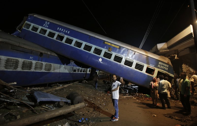 A man takes a selfie photo near the upturned coaches of the Kalinga-Utkal Express after an accident near Khatauli, in the northern Indian state of Uttar Pradesh, India, Sunday, Aug. 20, 2017. Several coaches of a passenger train derailed, causing fatalities and injuries in northern India on Saturday, officials said.