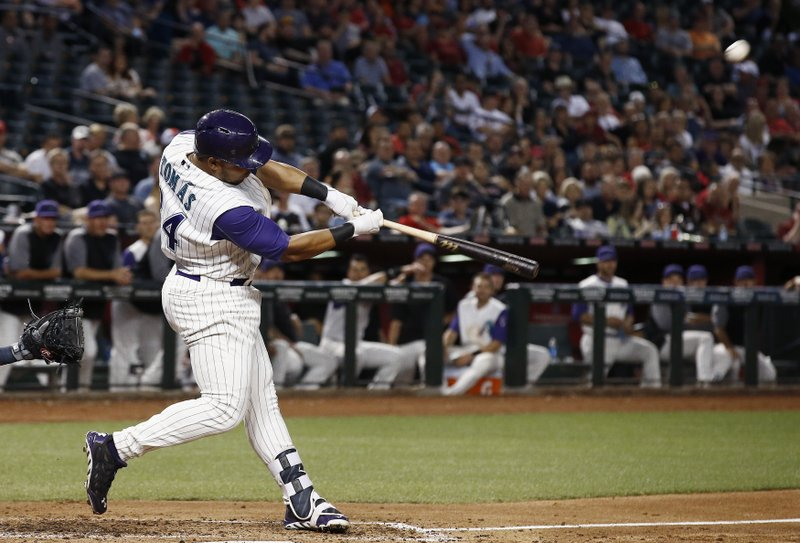 Arizona Diamondbacks' Yasmany Tomas swings for a two-run home run against the San Diego Padres during the fourth inning of a baseball game Thursday, April 27, 2017, in Phoenix. (AP Photo/Ross D. Franklin)