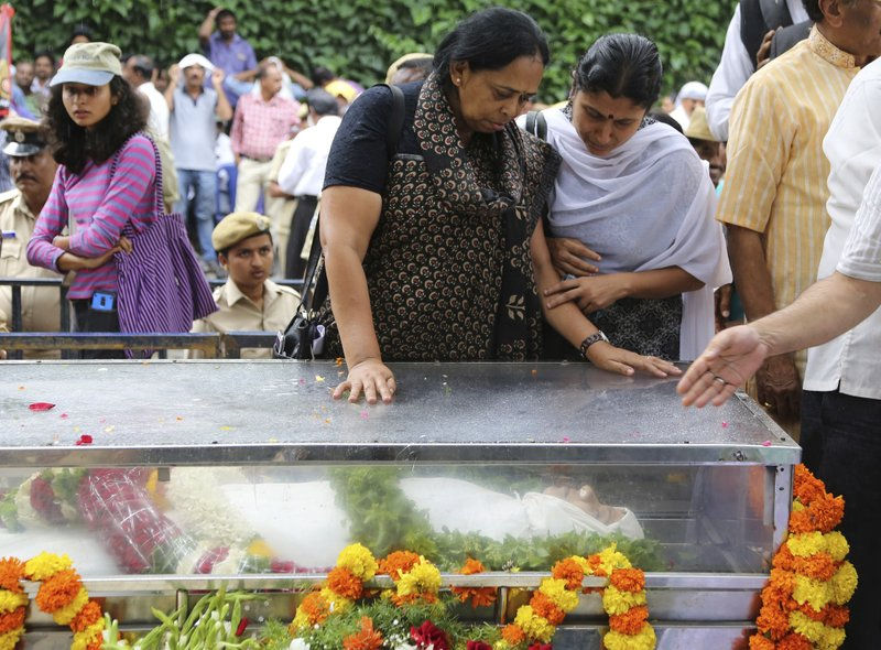 Mourners break down on seeing the body of Indian journalist Gauri Lankesh inside a casket placed for public viewing in Bangalore, India, Wednesday, Sept. 6, 2017. The Indian journalist was gunned down outside her home the southern city of Bangalore — the latest in a string of deadly attacks targeting journalists or outspoken critics of religious superstition and extreme Hindu politics.