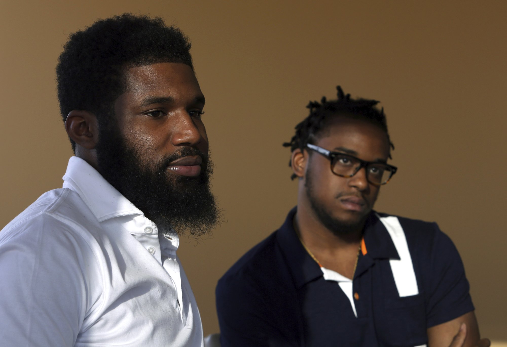 Black men arrested at Starbucks settle with the company