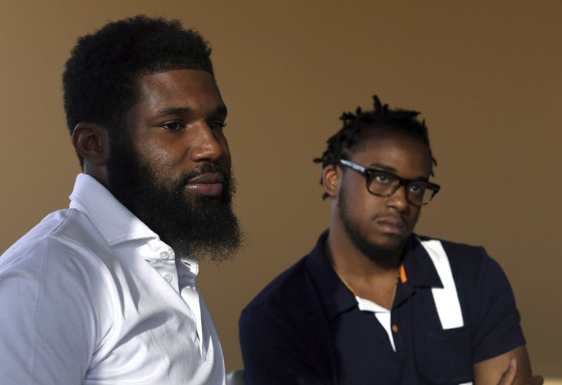 Starbucks reaches settlement with 2 arrested men