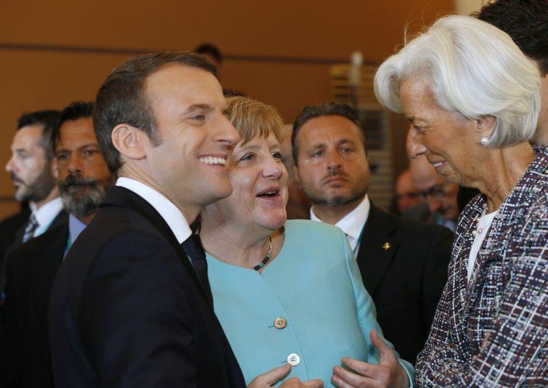 Risultati immagini per Merkel, Lagarde e Macron immagini
