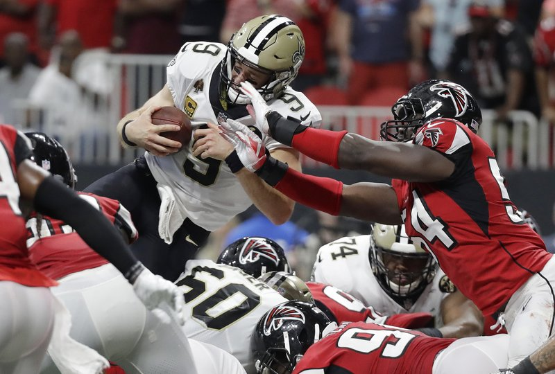 New Orleans Saints quarterback Drew Brees (9) leaps over the goal line for  a touchdown against the Atlanta Falcons during overtime of an NFL football  game 201ce0081