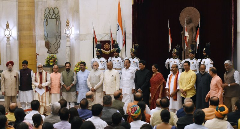 India Prime Minister Narendra Modi, seventh left, President Ramnath Kovind, eighth left and Vice President Venkiah Naidu, nineth left pose with the newly sworn-in ministers after a ceremony at the Presidential Palace in New Delhi, India, Sunday, Sept.3, 2017. Modi on Sunday reshuffled some of his key minister's portfolios to refurbish his government's image, which has been dented by falling economic indicators.