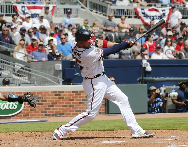 Atlanta Braves' catcher Tyler Flowers follows through on a two-run single in the fifth inning of a baseball game against the San Diego Padres Sunday, April 16, 2017, in Atlanta. (AP Photo/John Bazemore)