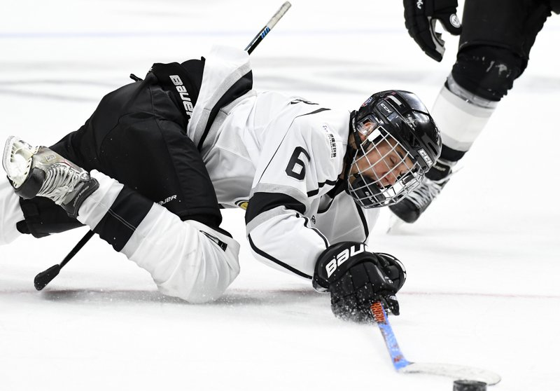 Image result for Justin Bieber Takes Tumble In Ice Hockey Game