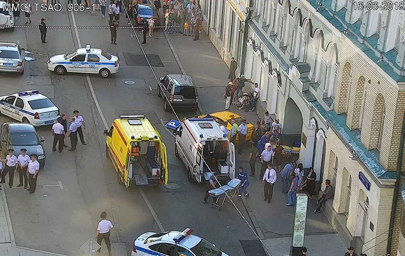 In this image provided by Moscow Traffic Control Center Press Service, ambulance and police work at the site of an incident after a taxi crashed into pedestrians on a sidewalk near Red Square in Moscow, Russia, Saturday, June 16, 2018. Police in Moscow say at least seven people have been injured when a taxi crashed into pedestrians on a sidewalk near Red Square.
