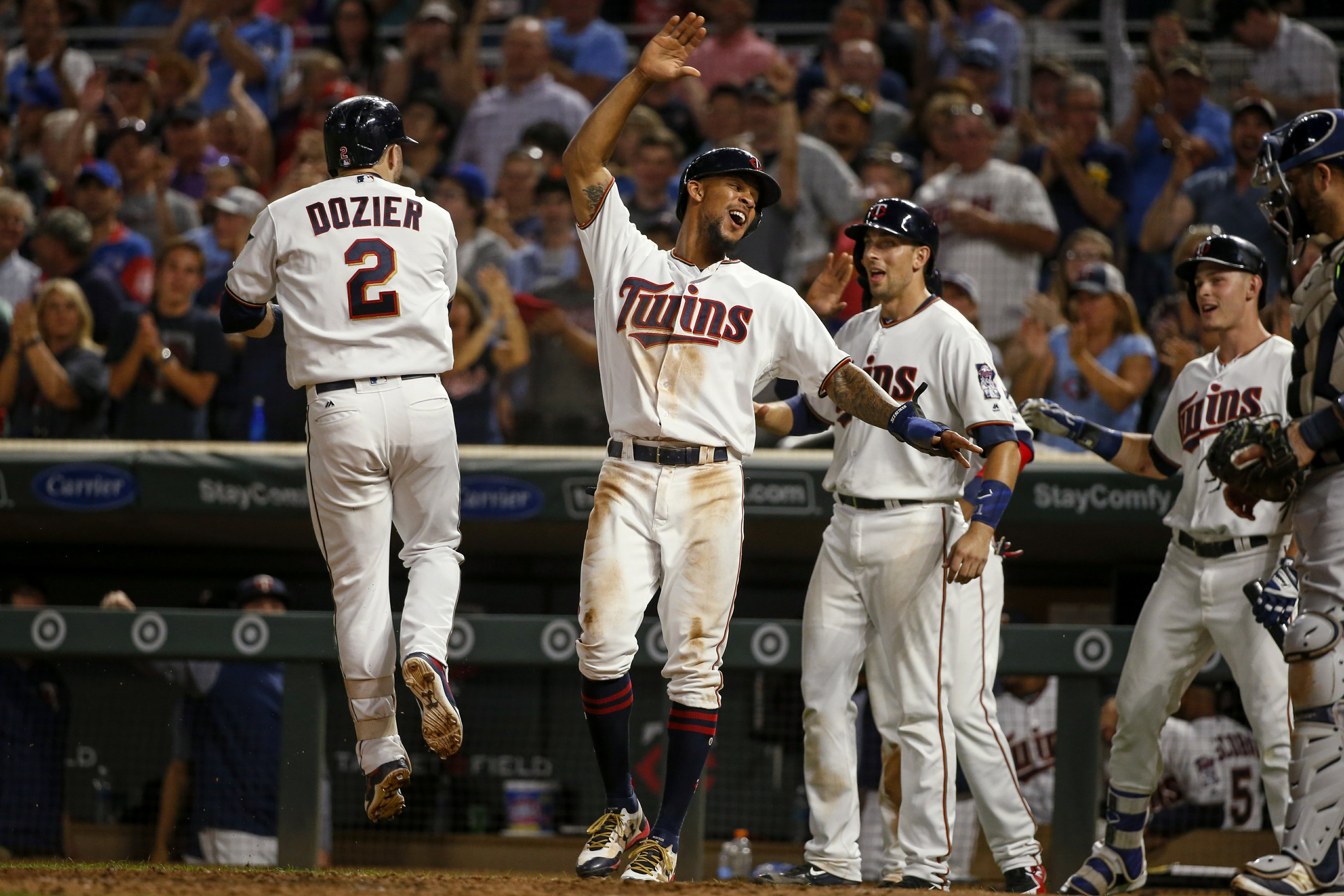 Dozier slam among 5 homers for Twins in 11-4 win vs  Brewers
