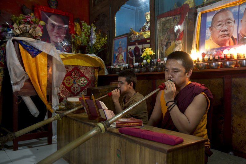 Exile Tibetan monks perform rituals inside a temple at Majnu Ka Tilla in New Delhi, India, Tuesday, April 4, 2017. India said Tuesday that China should not interfere in its internal affairs, as the Dalai Lama began a weeklong visit to India's remote northeast that Beijing has protested.