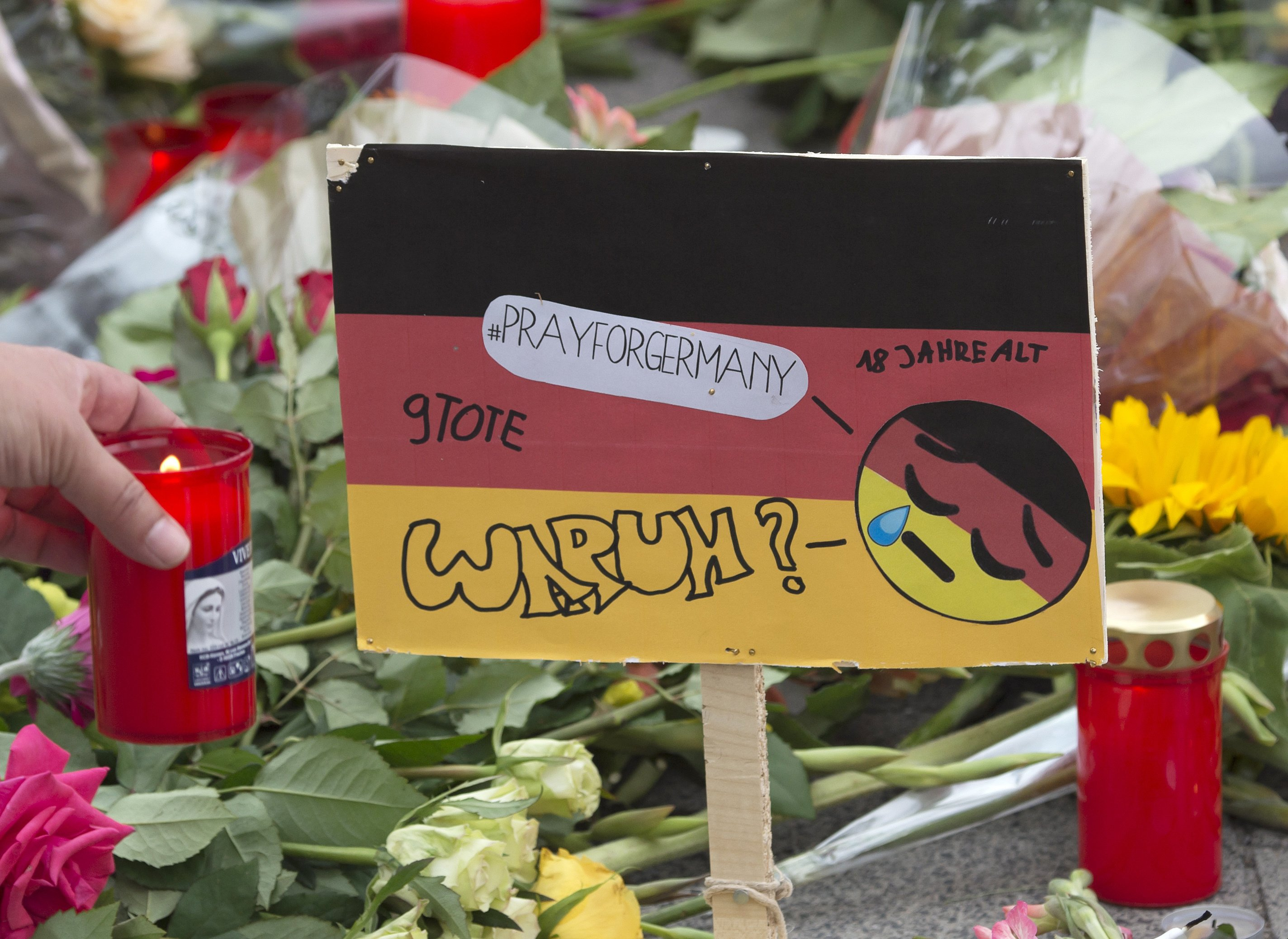 The Latest: Munich shooting scars those who witnessed it