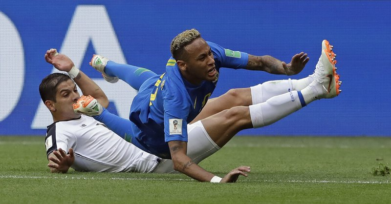Brazil's Neymar is brought down by Costa Rica's Cristian Gamboa during the group E match between Brazil and Costa Rica at the 2018 soccer World Cup in the St. Petersburg Stadium in St. Petersburg, Russia, Friday, June 22, 2018.