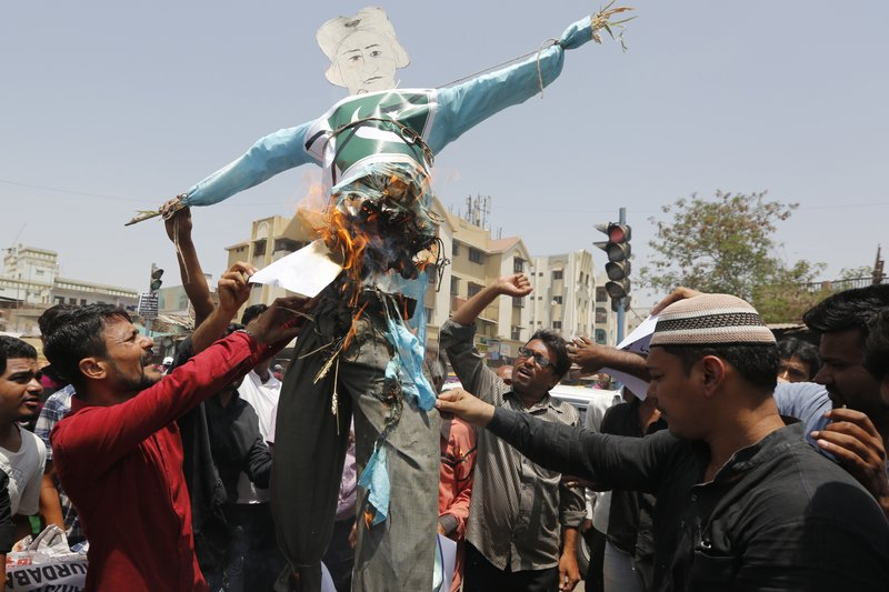 Indians burn an effigy of Pakistan and shout anti-Pakistan slogans during a protest in Ahmadabad, India, Wednesday, May 3, 2017. Two Indian soldiers were killed and their bodies mutilated Monday in an ambush by Pakistani soldiers along the highly militarized de facto border that divides the disputed region of Kashmir between the nuclear-armed rivals, the Indian army said. But Pakistan denied any such attack, calling the Indian claims false.