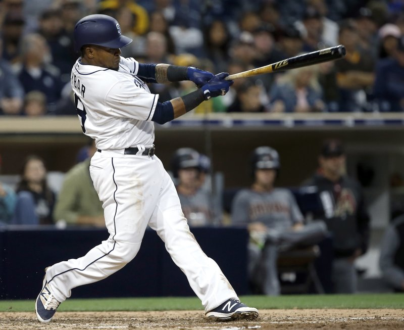 San Diego Padres' Erick Aybar hits a two-run double against the Arizona Diamondbacks during the fifth inning of a baseball game in San Diego, Thursday, April 20, 2017. (AP Photo/Alex Gallardo)