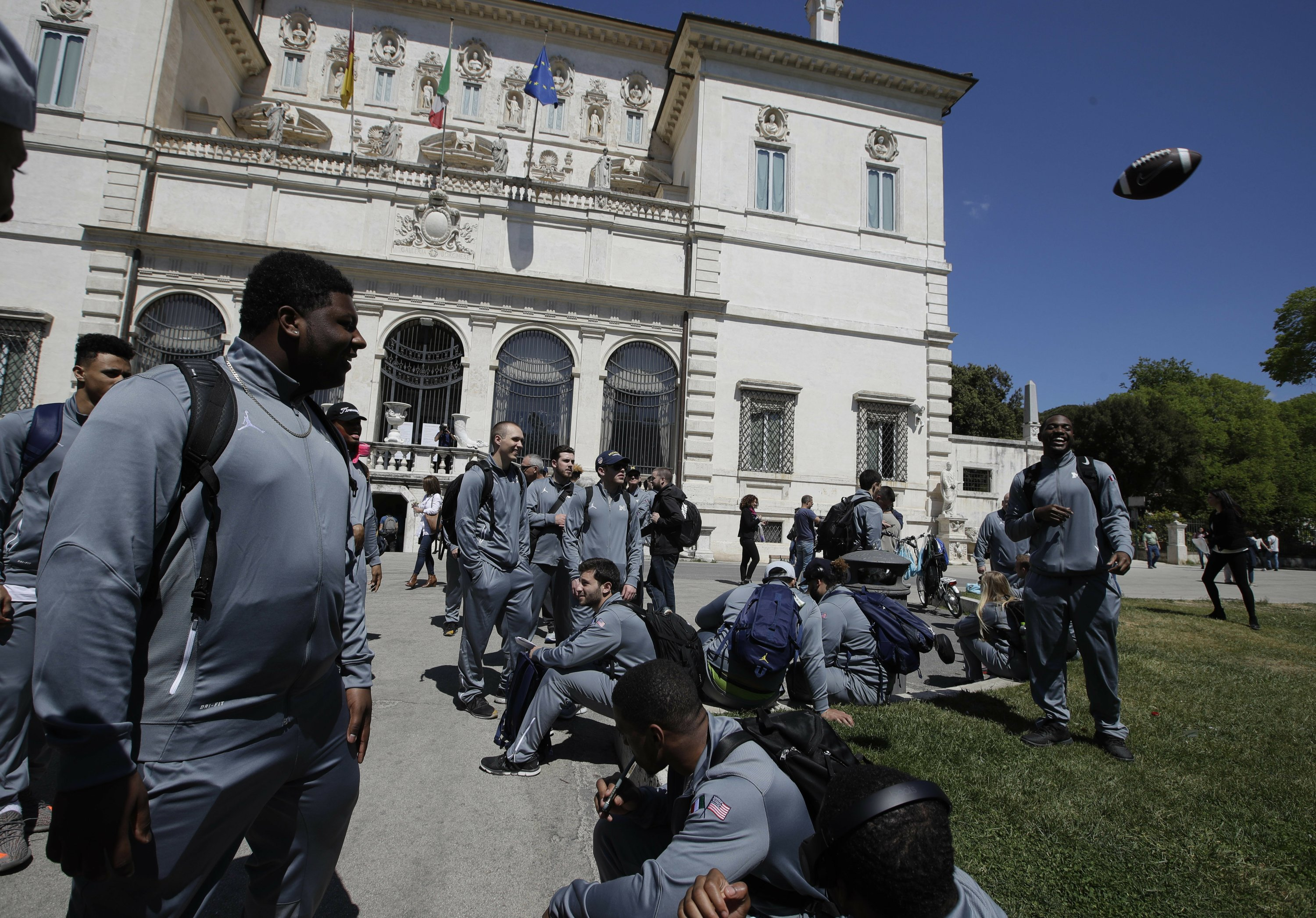 Michigan football team arrives in Italy