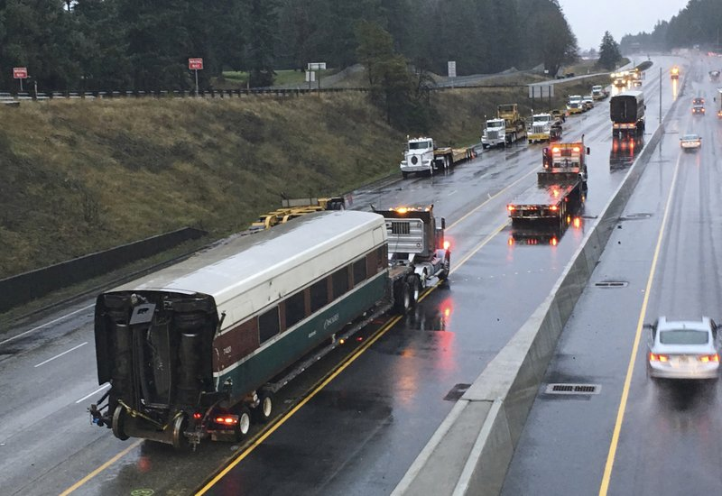 The Latest: Transit agency: Employee killed in derailment