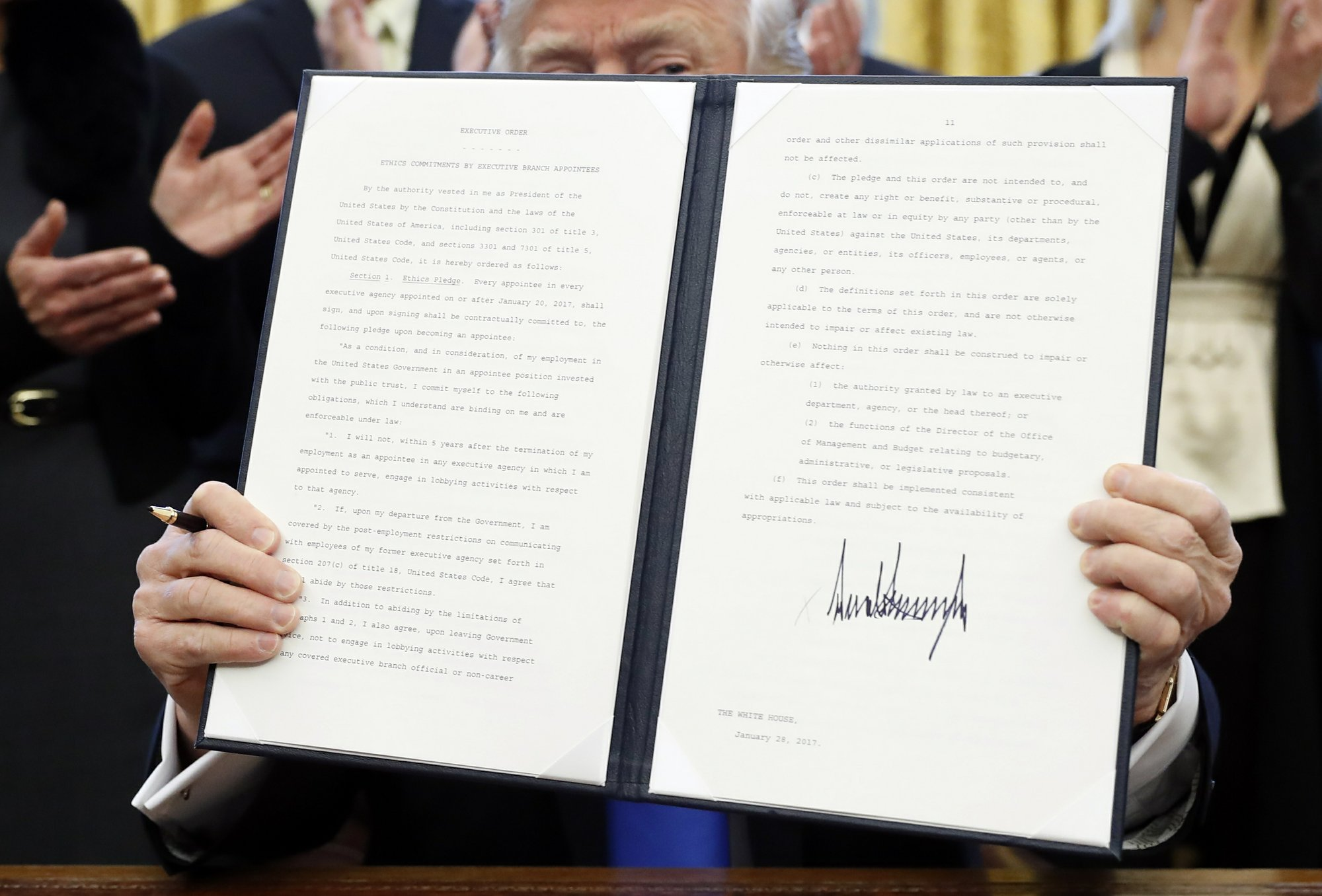 Trump sets 5-year and lifetime lobbying ban for officials