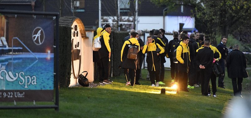 Dortmund players stand outside the team hotel after the team bus was damaged in an explosion before the Champions League quarterfinal soccer match between Borussia Dortmund and AS Monaco in Dortmund, western Germany, Tuesday, April 11, 2017.