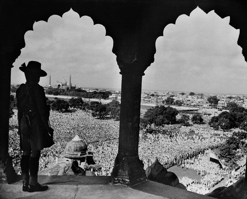 In this Aug. 15, 1948 file photo, an armed Gurkha towers over thousands Indians in a courtyard beneath the Red Fort celebrating the first anniversary of India's independence, in New Delhi. Premier Pandit Jawarhalal Nehru addressed the throngs at the celebrations which included hoisting the Dominion flag, at lower right. When the British ended two centuries of colonial rule on the Indian subcontinent in August 1947, they left a jigsaw legacy _ the vast country of India flanked on either side by a newly created Pakistan split in two parts. As the 70th anniversary of India-Pakistan Partition comes up next week, relations between the two nations are as broken as ever. In some ways, their violent birth pangs dictated their future course through suspicion and animosity.