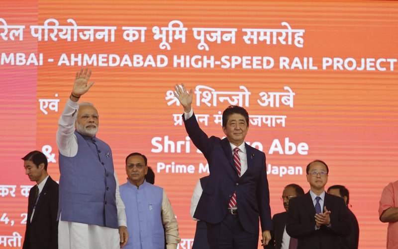 Japanese Prime Minister Shinzo Abe, right and Indian Prime Minister Narendra Modi wave during the ground breaking ceremony for high speed rail project in Ahmadabad, India, Thursday, Sept. 14, 2017.