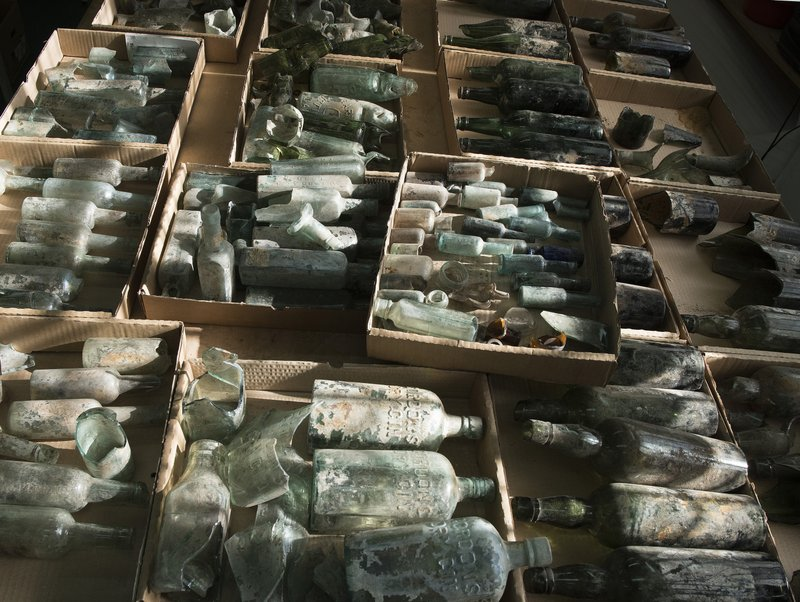 This undated photo provided by the Israel Antiquities Authority on Wednesday, March 22, 2017, shows century-old liquor bottles that belonged to British soldiers in World War I. The Israel Antiquities Authority said Wednesday it was excavating 250,000-year-old flint tools when the archaeologists stumbled upon hundreds of liquor bottles near a building where British soldiers were garrisoned in 1917.
