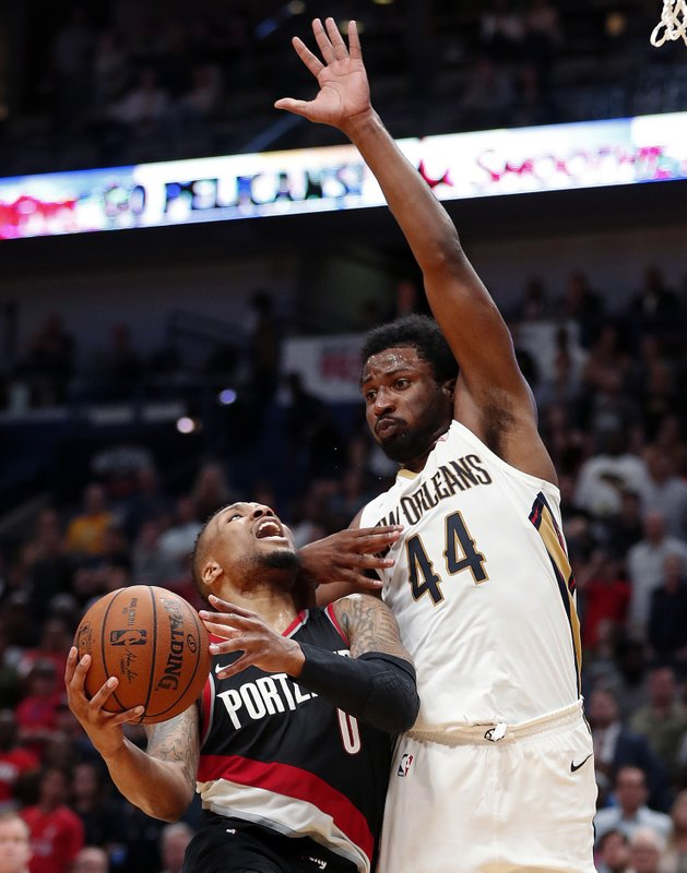 515ef3b98d78 Portland Trail Blazers guard Damian Lillard (0) goes to the basket against  New Orleans Pelicans forward Solomon Hill (44) in the second half of an NBA  ...