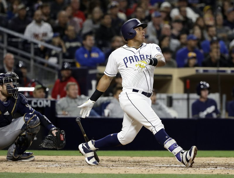 San Diego Padres' Yangervis Solarte watches his RBI double during the sixth inning of a baseball game against the Milwaukee Brewers on Wednesday, May 17, 2017, in San Diego. (AP Photo/Gregory Bull)