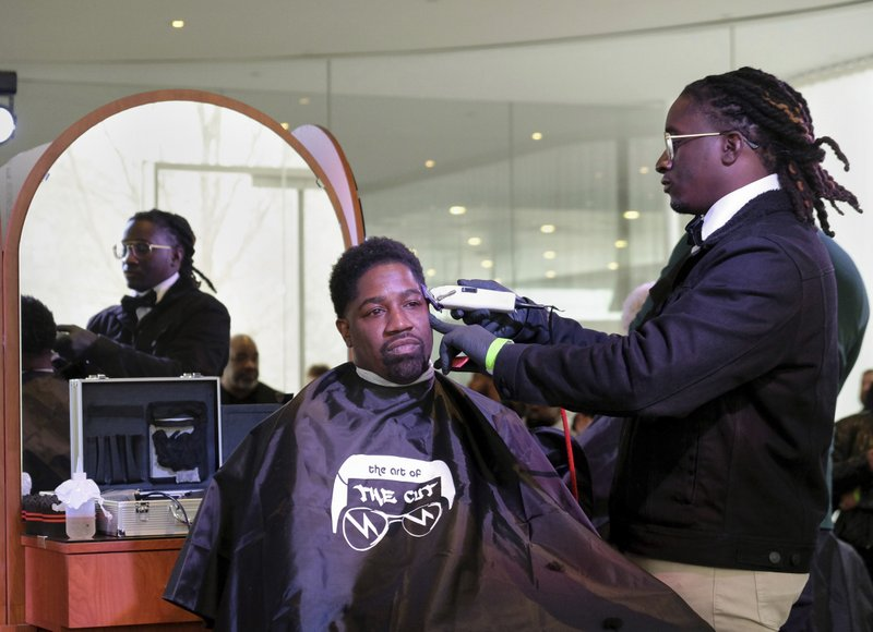 Art event on black barbershops blends hair history, health