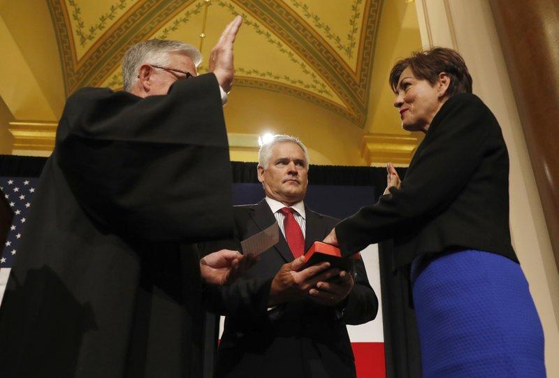 Kim Reynolds sworn in as Iowa's 1st female governor