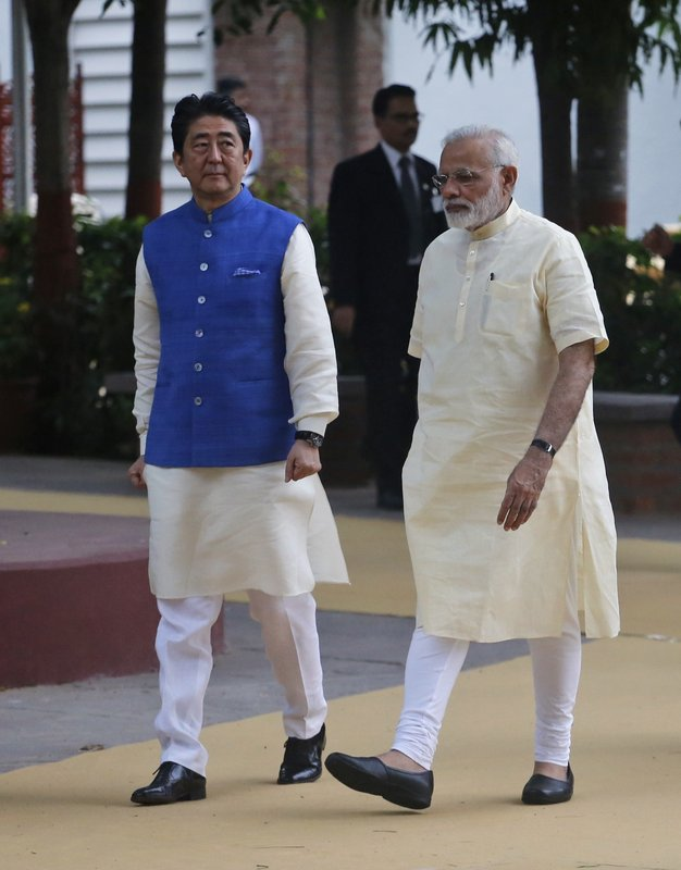 Japanese Prime Minister Shinzo Abe, left, and Indian Prime Minister Narendra Modi walk inside Sabarmati Ashram, or Gandhi Ashram, in Ahmadabad, India, Wednesday, Sept. 13, 2017. Abe is on a two-day official visit to India.