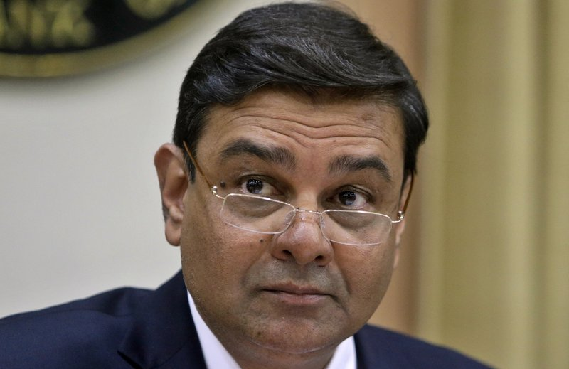 Reserve Bank of India Governor Urjit Patel, looks on during a press conference in Mumbai, India, Wednesday, Aug. 2, 2017. India's central bank Wednesday cuts its key interest rate by a quarter of a percentage point on Wednesday, raising hopes of lower borrowing costs for households as inflation ebbs.