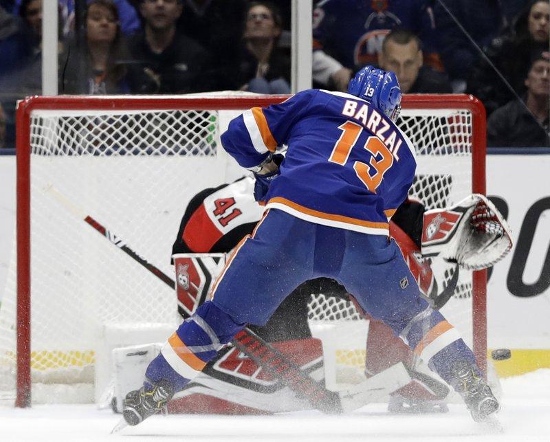 c7c89aa7a34 Islanders beat Senators in shootout for Trotz's 800th win