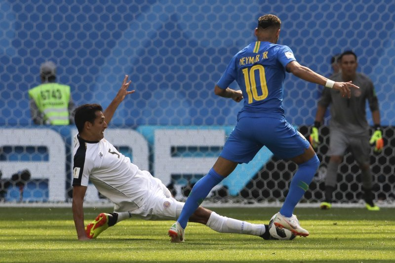 Brazil's Neymar, right, and Costa Rica's Celso Borges challenge for the ball during the group E match between Brazil and Costa Rica at the 2018 soccer World Cup in the St. Petersburg Stadium in St. Petersburg, Russia, Friday, June 22, 2018.