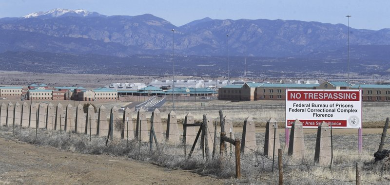 The Rocky Mountains can be seen in the distance behind the Federal Correctional Complex near Florence, Colorado. (Jerilee Bennett/The Gazette via AP)