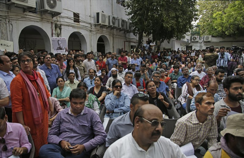 Journalists and others attend a protest meeting against the killing of Indian journalist Gauri Lankesh at Press Club of India in New Delhi, India, Wednesday, Sept. 6, 207. Even as police promise to hunt down the assailants who gunned down Lankesh outside her Bangalore home Tuesday night, many said they feared the perpetrators of this attack, like so many others, would get away with impunity.