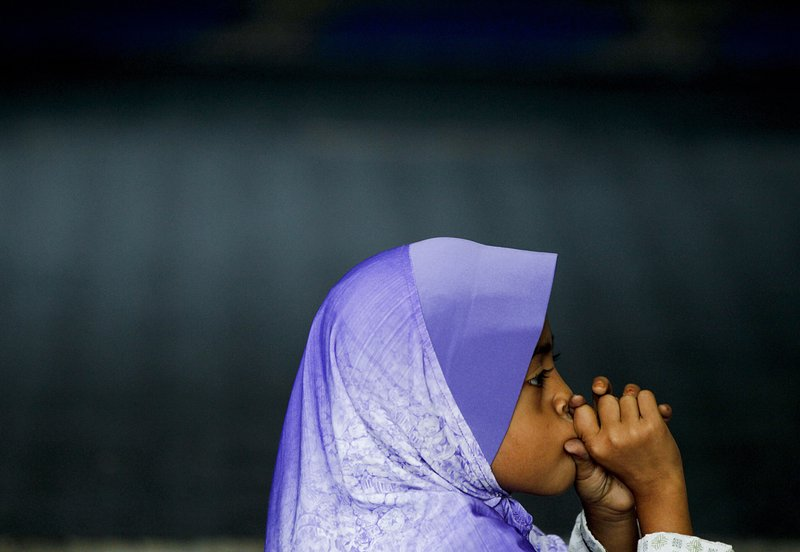 In this Tuesday, Sept. 12, 2017, photo, a Rohingya Muslim child living in Malaysia sits at a school in Klang, outside of Kuala Lumpur, Malaysia. Recent violence in Myanmar has driven hundreds of thousands of Rohingya Muslims to seek refuge across the border in Bangladesh. There are some 56,000 Rohingya refugees registered with the U.N. refugee agency in Malaysia, with an estimated 40,000 more whose status has yet to be assessed.