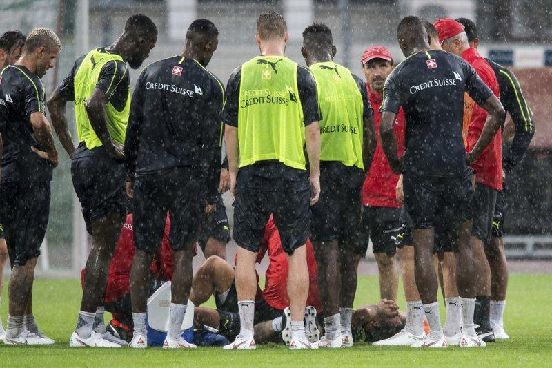 best service a33e3 9de23 Switzerland midfielder Xhaka limps away hurt from training
