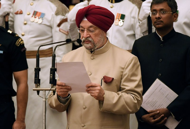 Former diplomat Hardeep Singh Puri, takes the oath during the swearing-in ceremony of new ministers at the Presidential Palace in New Delhi, India, Sunday, Sept.3, 2017. India Prime Minister Narendra Modi, on Sunday reshuffled some of his key minister's portfolios to refurbish his government's image, which has been dented by falling economic indicators.