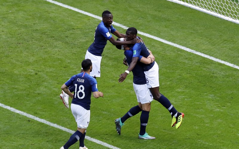 France's Paul Pogba, right, celebrates with teammates after scoring his side's second goal during the group C match between France and Australia at the 2018 soccer World Cup in the Kazan Arena in Kazan, Russia, Saturday, June 16, 2018.