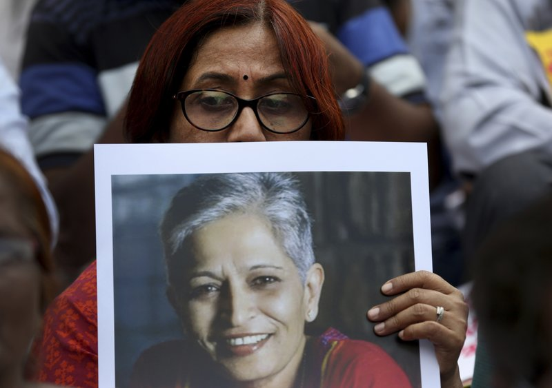 A participant holds a placard with a photograph of Indian journalist Gauri Lankesh at a protest demonstration against her killing in Bangalore, India, Wednesday, Sept. 6, 2017. The Indian journalist was gunned down outside her home the southern city of Bangalore — the latest in a string of deadly attacks targeting journalists or outspoken critics of religious superstition and extreme Hindu politics.