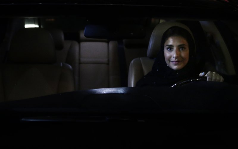 Hessah al-Ajaji sits in her car on the capital's busy Tahlia Street after driving for the first time in Riyadh, Saudi Arabia, Sunday, June 24, 2018. Saudi women are in the driver's seat for the first time in their country and steering their way through busy city streets just minutes after the world's last remaining ban on women driving was lifted on Sunday.