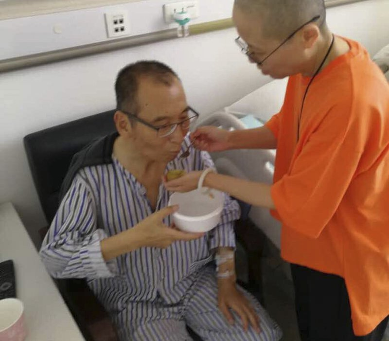 In this recent undated handout photo, Chinese dissident and Nobel Prize laureate Liu Xiaobo, left, is attended to by his wife Liu Xia in a hospital in China. The judicial bureau in the northeastern Chinese city of Shenyang says jailed Nobel Peace Prize laureate Liu Xiaobo has died of multiple organ failure Thursday, July 13, 2017, at age 61.