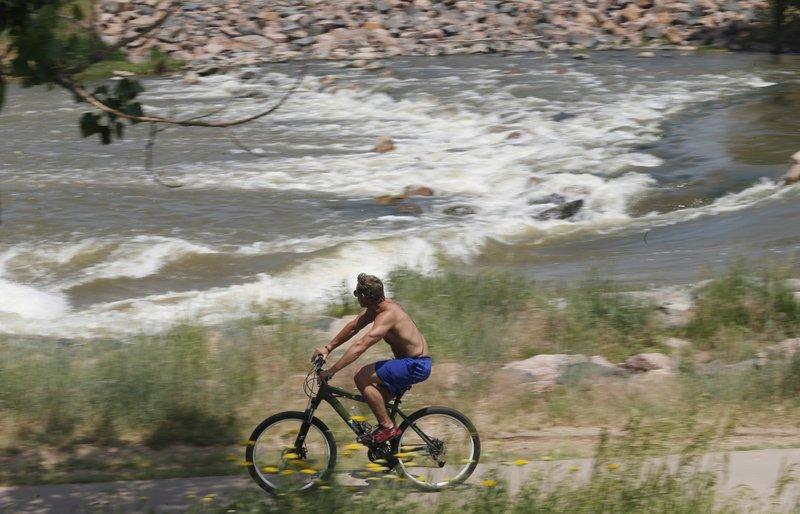 Bicyclist along the Platte River Trail, South Platte River
