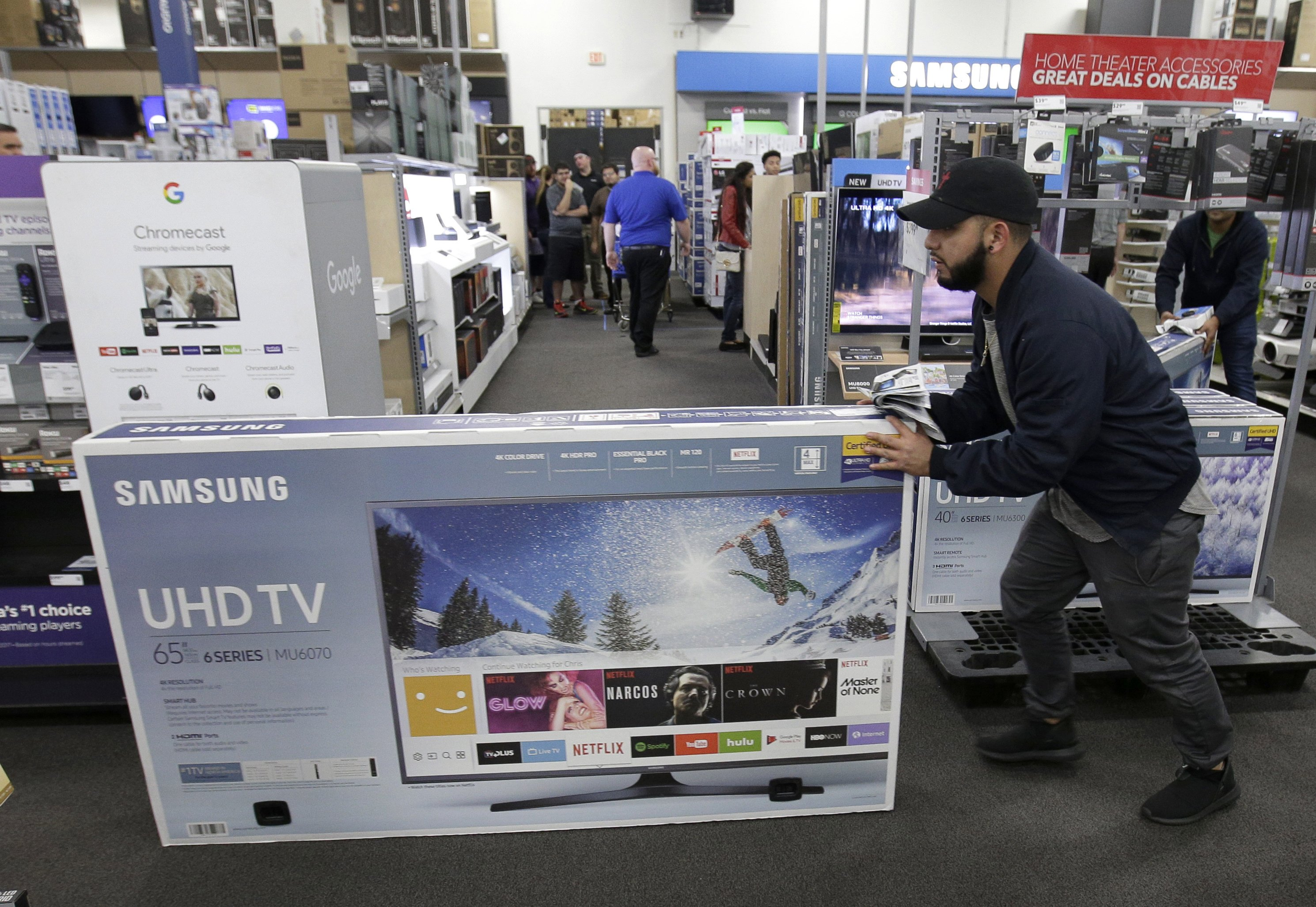 Shoppers spending more may make a merry season for retailers