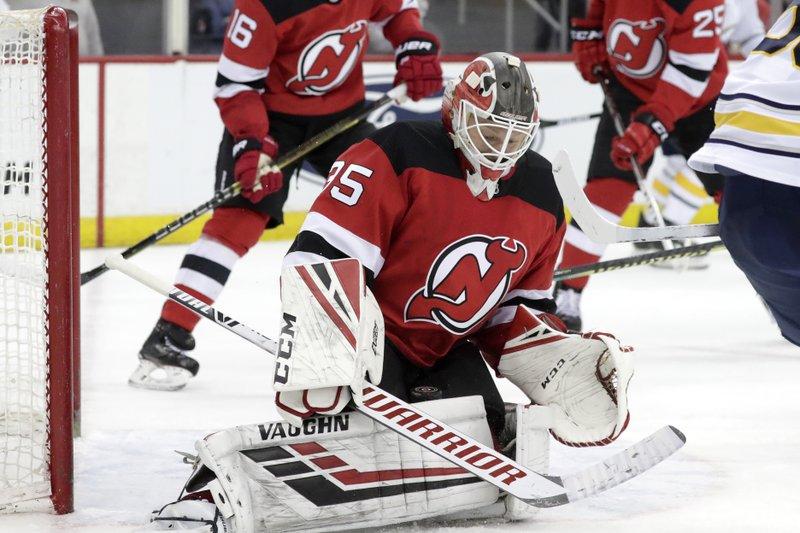 Schneider makes 45 saves in leading Devils over Sabres 3-1